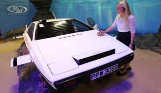 """The white Lotus Esprit (pictured) used in the James Bond movie """"The Spy Who Loved Me"""" was sold Monday at a London auction for $865,000. (AP Photo/PA, Sean Dempsey)"""