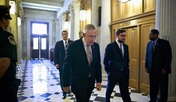 **FILE** Senate Majority Leader Harry Reid, Nevada Democrat, heads to the Senate floor on Sept. 6, 2013, to introduce a resolution for the authorization of military action in support of President Obama's request for a strike against Syria. (Associated Press)