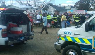 Several children were injured when a festival attraction that swings riders into the air lost power at a community fair in Norwalk, Conn, on Sunday Sept. 8, 2013, but none of the injuries appeared to be life-threatening, authorities said. (AP Photo/The Hour Miguel Cruz)