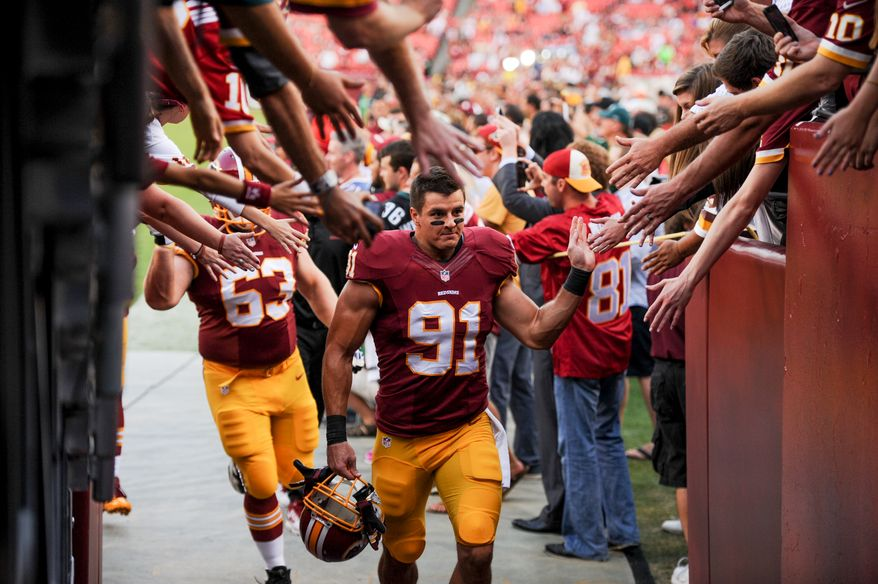 Washington Redskins linebacker Ryan Kerrigan (91) beds back into the locker room after pre game warm ups as the Washington Redskins play the Philadelphia Eagles in Monday Night NFL football at FedExField, Landover, Md., Monday, September 9, 2013. (Andrew Harnik/The Washington Times)