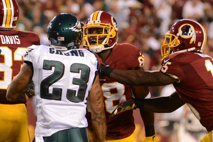 Philadelphia Eagles free safety Patrick Chung (23) and Washington Redskins wide receiver Pierre Garcon (88) are broken up after Washington Redskins running back Alfred Morris (46) fumbles on the first offensive play of the game as the Washington Redskins play the Philadelphia Eagles in Monday Night NFL football at FedExField, Landover, Md., Monday, September 9, 2013. (Andrew Harnik/The Washington Times)