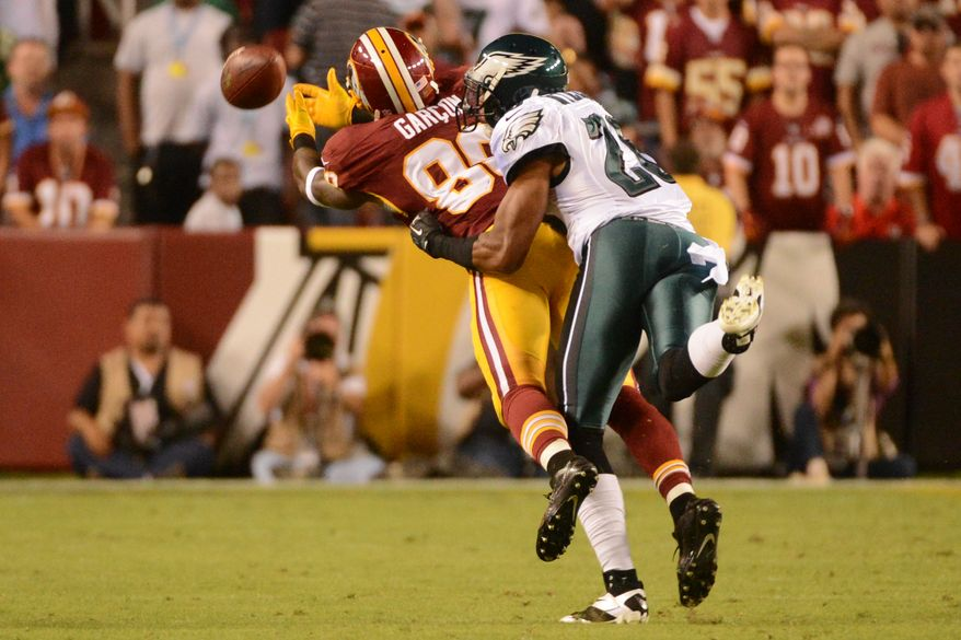 A ball intended for Washington Redskins wide receiver Pierre Garcon (88) is overthrown in the second quarter as the Washington Redskins play the Philadelphia Eagles in Monday Night NFL football at FedExField, Landover, Md., Monday, September 9, 2013. (Andrew Harnik/The Washington Times)
