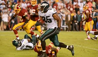 Philadelphia Eagles running back LeSean McCoy (25) scores on a 34 yard run in the second quarter as the Washington Redskins play the Philadelphia Eagles in Monday Night NFL football at FedExField, Landover, Md., Monday, September 9, 2013. (Andrew Harnik/The Washington Times)