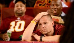 Fans sit dejected in the stands in the third quarter as the Washington Redskins play the Philadelphia Eagles in Monday Night NFL football at FedExField, Landover, Md., Monday, September 9, 2013. (Andrew Harnik/The Washington Times)