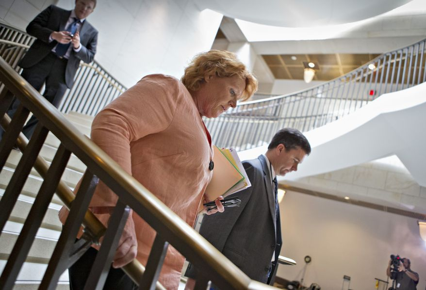 Sen. Heidi Heitkamp (center), North Dakota Democrat, arrives to join other lawmakers and national security officials on Capitol Hill in Washington on Thursday, Sept. 5, 2013, for a closed-door briefing on the situation in Syria. (AP Photo/J. Scott Applewhite)