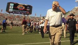 Frank Beamer, head coach of the Virginia Tech football team heads towards the locker room after an NCAA  college football game against Western Carolina in Blacksburg Va. Saturday Sept. 7 2013. Virginia Tech won the game 44-3.  (AP Photo / The Roanoke Times, Matt Gentry)