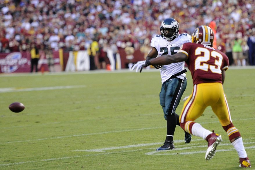 Washington Redskins cornerback DeAngelo Hall (23) recovers a backwards pass intended for Philadelphia Eagles running back LeSean McCoy (25) and brings it back for a first quarter touchdown as the Washington Redskins play the Philadelphia Eagles in Monday Night NFL football at FedExField, Landover, Md., Monday, September 9, 2013. (Dan Decook / For The Washington Times)