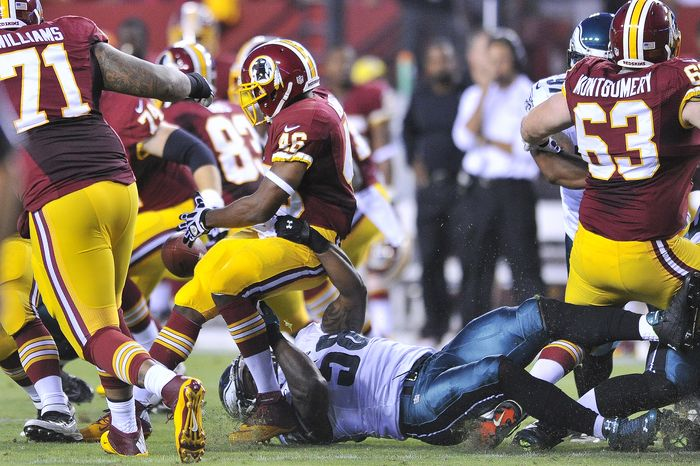 Washington Redskins running back Alfred Morris (46) fumbles on the first offensive play from scrimmage as the Washington Redskins play the Philadelphia Eagles in Monday Night NFL football at FedExField, Landover, Md., Monday, September 9, 2013. (Preston Keres / For The Washington Times)