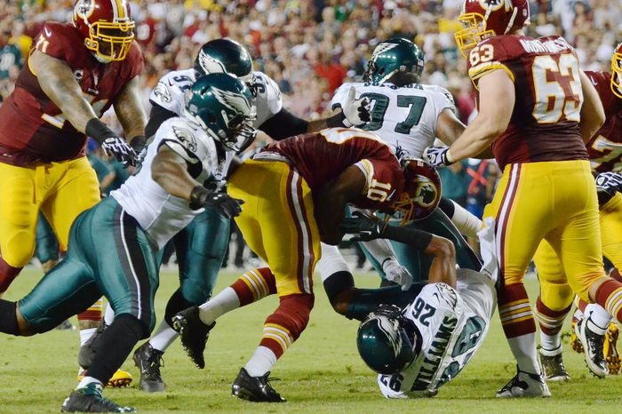 The Eagles defense takes down Washington Redskins quarterback Robert Griffin III (10) in the second quarter as the Washington Redskins play the Philadelphia Eagles in Monday Night NFL football at FedExField, Landover, Md., Monday, September 9, 2013. (Dan DeCook / For The Washington Times)