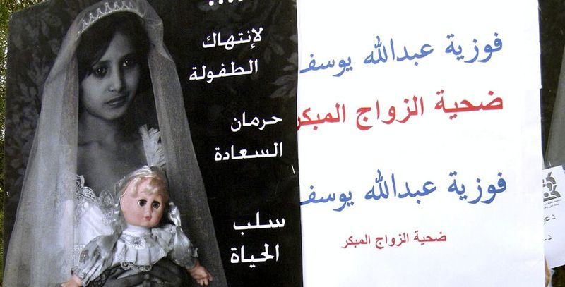 ** FILE ** A poster denouncing child marriage outside the parliament in Sana'a, Yemen. (Associated Press)