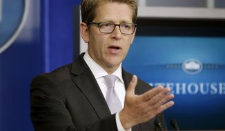 "White House press secretary Jay Carney gestures during his daily news briefing at the White House in Washington, Monday, Sept., 9, 2013. The White House is ""highly skeptical"" of the Russian proposal to allow international inspectors into Syria to examine that country's chemical weapons stockpile, Carney said. (AP Photo/Pablo Martinez Monsivais)"