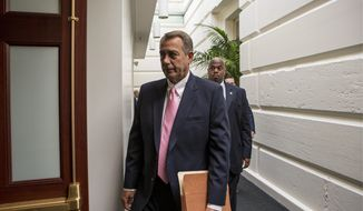 House Speaker John A. Boehner, Ohio Republican, walks to join other GOP House members for a caucus meeting on Capitol Hill in Washington on Tuesday, Sept. 10, 2013. Some conservative Republicans want to shut down the government on Oct. 1 if that's what it takes to block the Obamacare health program. (AP Photo/J. Scott Applewhite)