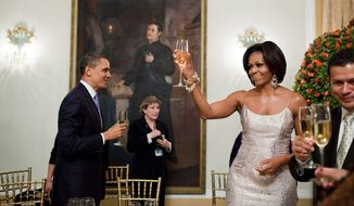 President Barack Obama and First Lady Michelle Obama toast during an official dinner hosted by Salvadoran President Mauricio Funes at the National Palace in San Salvador, El Salvador, March 22, 2011. (Official White House Photo by Pete Souza)