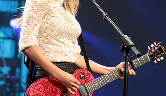 In this May 11, 2013 photo, Taylor Swift performs onstage during her Red Tour at the Verizon Center in Washington D.C. Swift and Kacey Musgraves top the list of nominees for the CMA Awards with six nominations each. (Photo by Owen Sweeney/Invision/AP, File)