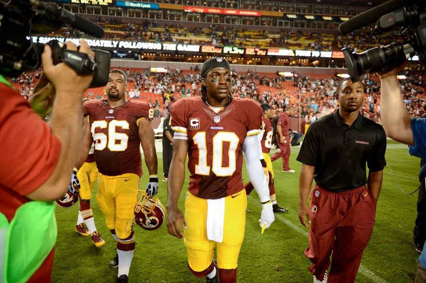 Washington Redskins quarterback Robert Griffin III (10) walks the field as the Washington Redskins lose to the Philadelphia Eagles 33-27 in Monday Night NFL football at FedExField, Landover, Md., Monday, September 9, 2013. (Andrew Harnik/The Washington Times)