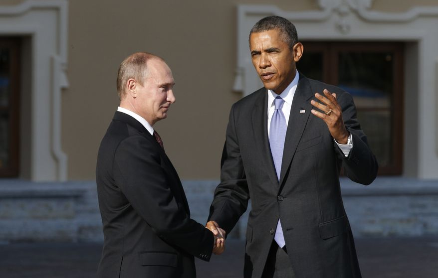 ** FILE ** U.S. President Barack Obama, right, speaks with Russia's President Vladimir Putin during arrivals for the G-20 summit at the Konstantin Palace in St. Petersburg, Russia on Thursday, Sept. 5, 2013. (AP Photo/Alexander Zemlianichenko)