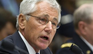 ** FILE ** Defense Secretary Chuck Hagel testifies on Capitol Hill on Sept. 10, 2013, before the House Armed Services Committee hearing on the proposed authorization to use military force in Syria. (Associated Press)