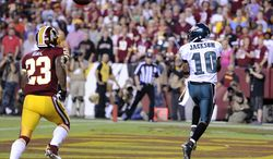 Philadelphia Eagles wide receiver DeSean Jackson (10) hauls in a first quarter touchdown pass in front of Washington Redskins cornerback DeAngelo Hall (23) as the Washington Redskins play the Philadelphia Eagles in Monday Night NFL football at FedExField, Landover, Md., Monday, September 9, 2013. (Preston Keres / For The Washington Times)