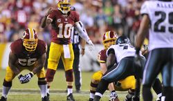 Washington Redskins quarterback Robert Griffin III (10) screams to snap the ball as time runs out  on the play clock caussing a delay of game late in the fourth quarter as the Washington Redskins play the Philadelphia Eagles in Monday Night NFL football at FedExField, Landover, Md., Monday, September 9, 2013. (Preston Keres / For The Washington Times)
