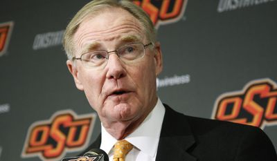 FILE - In this Friday, Nov. 18, 2011 file photo, Oklahoma State University president Burns Hargis speaks during a news conference in Stillwater, Okla. Chesapeake Energy Corp. shareholders showed their displeasure with the company's board by withholding support for two directors up for re-election at Friday's annual meeting. Both directors have tendered their resignation. Hargis is one of the two directors who resigned Friday. (AP Photo/Sue Ogrocki, File)
