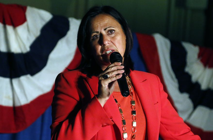 Democratic state Sen. Angela Giron waves to supporters as she gives her concession speech after she lost in a recall vote in Pueblo, Colo., on Sept. 10, 2013. Giron was one of two Colorado state lawmakers who backed gun-control measures in the aftermath of the mass shootings in Colorado and Connecticut last year that have been ousted in recall elections. (Associated Press)