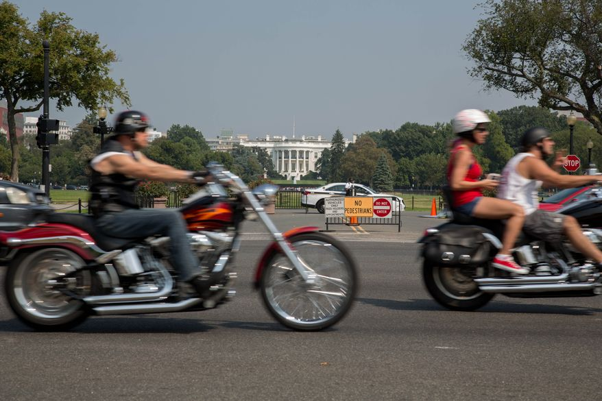 Motorcycle riders from across the country ride into the district to honor those who had fallen during the events of 9/11, in Washington, DC.,  Wednesday, September 11, 2013.  (Andrew S Geraci/The Washington Times)