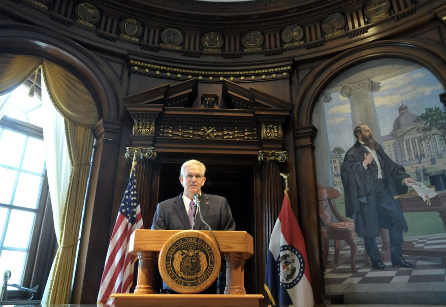 Missouri Gov. Jay Nixon, speaking in the Capitol in Jefferson City, Mo., on Friday, July 12, 2013, addresses the nearly three dozen pieces of legislation he has vetoed. (AP Photo/The Jefferson City News-Tribune, Julie Smith)