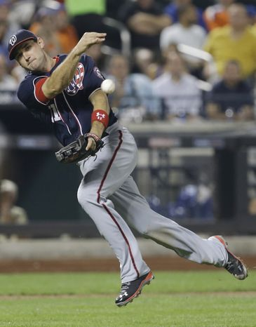 Ryan Zimmerman makes an on-point throw in the Nationals' 3-0 victory over the New York Mets on Wednesday night. Zimmerman also homered for the seventh time in nine games. (Associated Press photo)