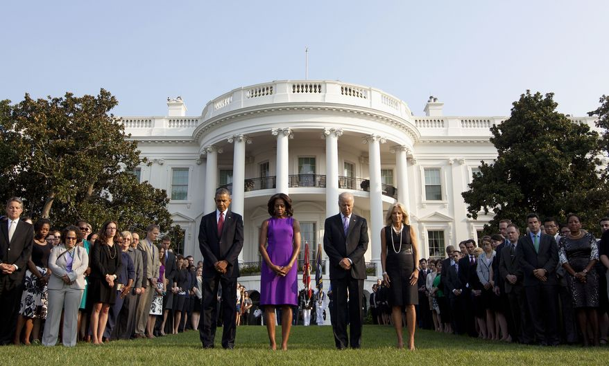 President Obama (from left), first lady Michelle Obama, Vice President Joseph R. Biden and Jill Biden join members of the White House staff during a moment of silence on Wednesday, Sept. 11, 2013, on the South Lawn of the White House in Washington to mark the 12th anniversary of the 9/11 attacks. (AP Photo/Pablo Martinez Monsivais)