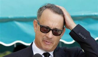 ** FILE ** Actor Tom Hanks arrives at the Michael Clarke Duncan Memorial Service at Forest Lawn Memorial-Park and Mortuaries in the Hollywood Hills selection of Los Angeles, September 10, 2012. (AP Photo/Nick Ut)