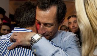 ** FILE ** Democratic mayoral hopeful Anthony Weiner greets voters after making his concession speech at Connolly's Pub in midtown Tuesday, Sept. 10, 2013, in New York. Public Advocate Bill de Blasio held a clear lead Tuesday night in New York City's mayoral Democratic primary as polls closed, according to early and incomplete voting returns. (AP Photo/Jin Lee)(AP Photo/Jin Lee)