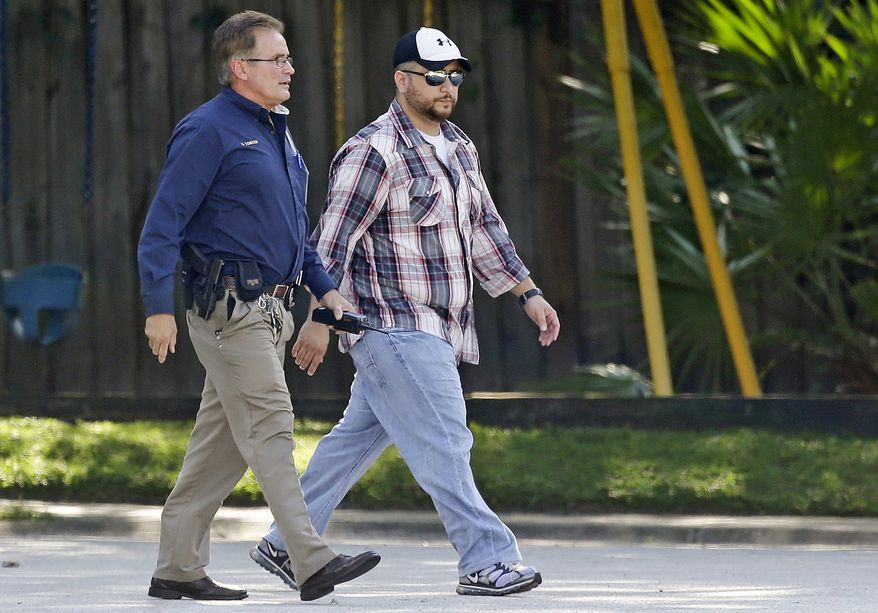 George Zimmerman, right, is escorted to a home by a Lake Mary police officer, Monday, Sept. 9, 2013, in Lake Mary, Fla., after a domestic incident in the neighborhood where Zimmerman and his wife Shellie had lived during his murder trial. (AP Photo/John Raoux)