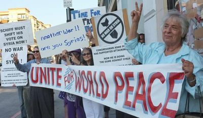 Joyce Brody (right) joins anti-war activists at a rally for peace outside the offices of Rep. Adam B. Schiff, California Democrat and a member of the intelligence committee, to urge him to vote against a military strike on Syria. (Associated Press)
