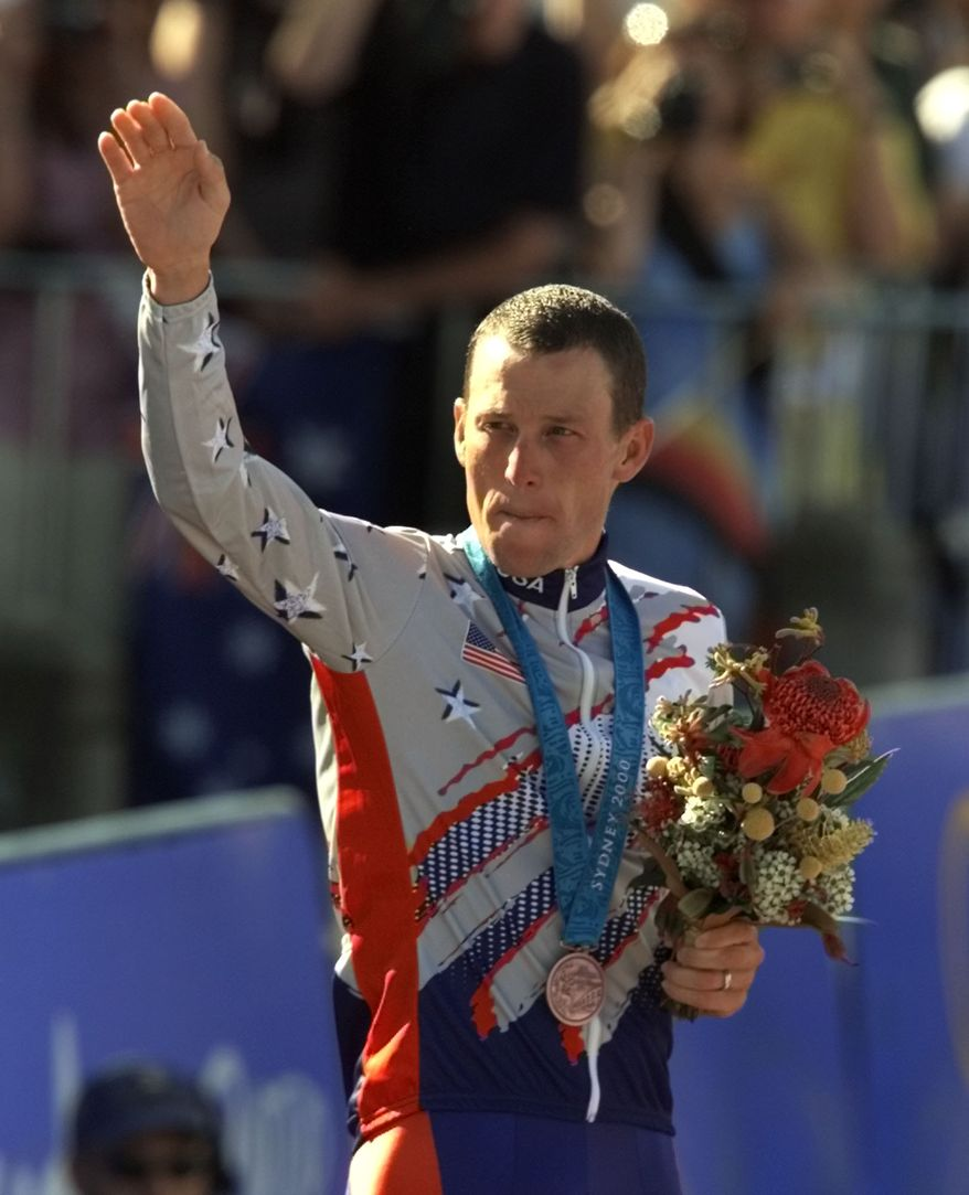 FILE - In a Sept. 30, 2000 file photo, U.S. cyclist Lance Armstrong waves after receiving the bronze medal in the men's individual time trials at the 2000 Summer Olympics cycling road course in Sydney, Australia. Officials familiar with the decision tell The Associated Press the IOC has stripped Armstrong of his bronze medal from the 2000 Sydney Olympics because of his involvement in doping. Two officials say the IOC sent a letter to Armstrong on Wednesday night, Jan. 16, 2013,  asking him to return the medal.  (AP Photo/Ricardo Mazalan, File)