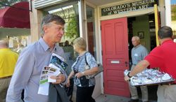 **FILE** During a two-day tour of rural parts of the state, Colorado Democratic Gov. John Hickenlooper leaves the A.R. Mitchell Memorial Museum of Western Art, in Trinidad, Colo., on Aug. 14, 2013. (Associated Press)