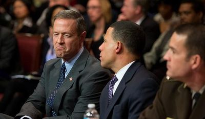 Maryland Gov. Martin O'Malley, left, speaks with Maryland Lt. Gov. Anthony Brown, second from right, after testifying at a Judicial Proceedings Committee hearing to urge state lawmakers to pass legislation requiring residents to obtain a license before purchasing a handgun, ban assault weapons, limit magazine capacities to 10 rounds and require prospective gun buyers to complete a safety course and pay a $100 application fee, Annapolis, Md., Wednesday, February 6, 2013. (Andrew Harnik/The Washington Times)