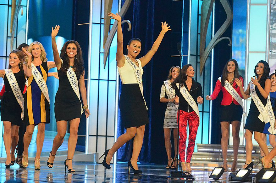 Contestants dance on the runway during the opening number of the preliminary competition of the 2014 Miss America Pageant at Boardwalk Hall on Tuesday Sept. 10, 2013, in Atlantic City, N.J.  The preliminary competitions began Tuesday, which is back in Atlantic City after a six-year absence. (AP Photo/The Press of Atlantic City, Ben Fogletto)
