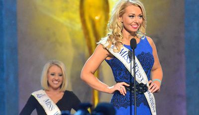 Miss West Virginia, Miranda Harrison, speaks during the preliminary competition of the Miss America Pageant at Boardwalk Hall on Tuesday Sept. 10, 2013, in Atlantic City, N.J. The preliminary competitions began Tuesday, which is back in Atlantic City after a six-year absence. (AP Photo/The Press of Atlantic City, Ben Fogletto)