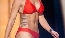 Miss Kansas Theresa Vail says she wants to break the stereotype that women with visible tattoos don't compete in pageants. Can you figure out what her tattoo says? It's the serenity prayer. (credit: AP)