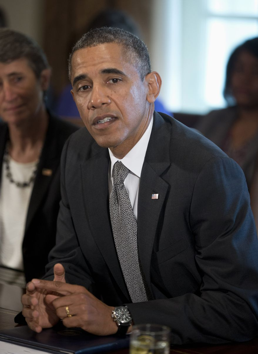 President Obama speaks to members of the media before a cabinet meeting on Sept. 12, 2013, in the Cabinet Room of the White House in Washington. At left is Interior Secretary Sally Jewell. (Associated Press)
