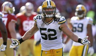 Green Bay Packers outside linebacker Clay Matthews (52) gestures during the fourth quarter of an NFL football game against the San Francisco 49ers in San Francisco, Sunday, Sept. 8, 2013. The 49ers won 34-28. (AP Photo/Ben Margot)