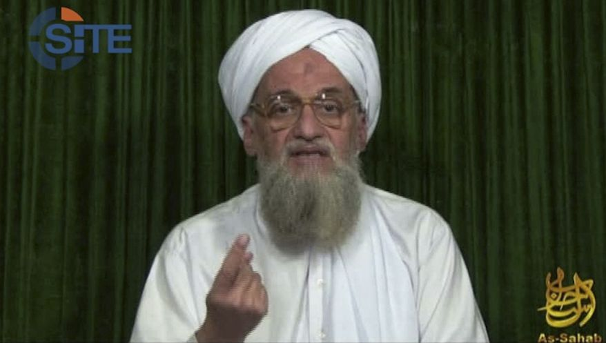 """** FILE ** This file image from video the AP obtained Feb. 12, 2012, from the SITE Intel Group, an American private terrorist threat analysis company, shows al Qaeda's leader Ayman al-Zawahri in a web posting by al Qaeda's media arm, as-Sahab, calling on Muslims across the Arab world and beyond to support rebels in Syria who are seeking to overthrow President Bashar Assad. Al-Zawahri marked the 12th anniversary of the Sept. 11, 2001, attacks by calling on Muslims to strike inside the United States, using any opportunity they can to """"bleed"""" America financially, speaking in an audio message released Thursday, Sept. 12, 2013. (AP Photo/SITE Intel Group, File)"""