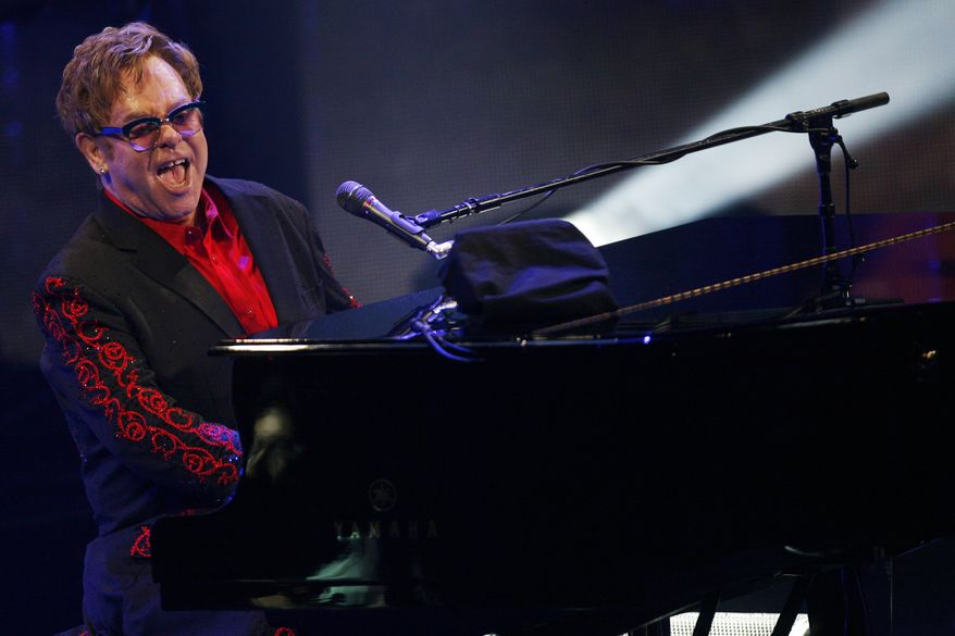 Elton John performs at the Roundhouse in London as part of the iTunes Festival on Thursday, Sept. 12, 2013. (Jim Ross/Invision/AP)