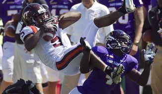 Virginia Tech's Joshua Stanford (5) pulls down a pass from quarterback Logan Thomas over East Carolina's Detric Allen (4) for a gain of nine yards in a the fourth quarter of an NCAA college football game at Dowdy-Ficklen Stadium in Greenville, N.C., Saturday, Sept. 14, 2013. (AP Photo/The News & Observer, Robert Willett)