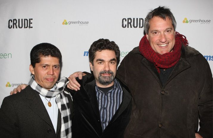 Attorney Pablo Fajardo, Joe Berlinger and attorney Steven Donziger attend the Sundance Greenhouse after-party for Crude, Sunday, Jan. 18, 2009 in Park City, Utah. (AP Photo/Shea Walsh)