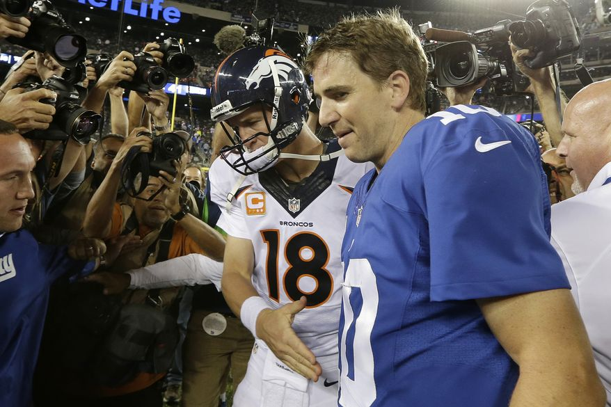 Denver Broncos quarterback Peyton Manning (18) shakes hands with his brother New York Giants' Eli Manning (10) after an NFL football game Sunday, Sept. 15, 2013, in East Rutherford, N.J. The Broncos won the game 41-23. (AP Photo/Frank Franklin II)