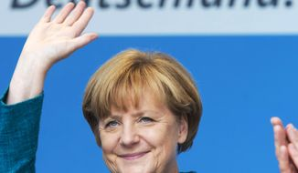 German Chancellor Angela Merkel waves during an election campaign event of the Christian Democratic Union (CDU) party in Bad Koestritz, Germany, on Sunday, Sept. 15, 2013. (AP Photo/Jens Meyer)