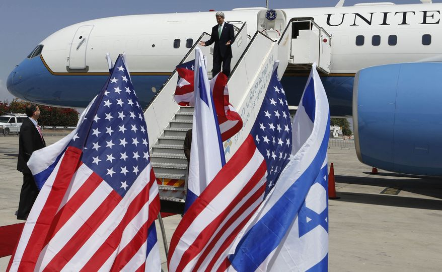 Secretary of State John F. Kerry arrives at Ben Gurion Airport in Tel Aviv on Sunday, Sept. 15, 2013, for a meeting with Israeli Prime Minister Benjamin Netanyahu, one day after sealing a deal with Russia on securing Syria's chemical weapons stockpiles. Mr. Kerry made a stop in Jerusalem to brief Mr. Netanyahu on the agreement as well as discuss developments in the Israeli-Palestinian peace process. (AP Photo/Larry Downing, Pool)