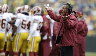 Washington Redskins head coach Mike Shanahan argues a call during the first half of an NFL football game against the Green Bay Packers Sunday, Sept. 15, 2013, in Green Bay, Wis. (AP Photo/Tom Lynn)