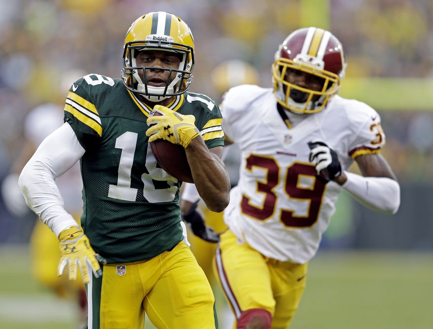 Green Bay Packers' Randall Cobb breaks away from Washington Redskins' David Amerson (39) for a 35-heard touchdown reception during the first half of an NFL football game Sunday, Sept. 15, 2013, in Green Bay, Wis. (AP Photo/Tom Lynn)